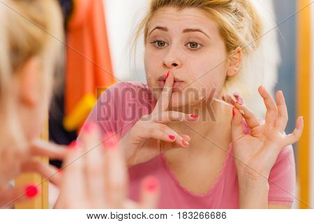Woman Removing Peel Off Mask From Her Face