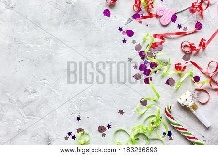 Colored party set with confetti on stone table background top view mock up