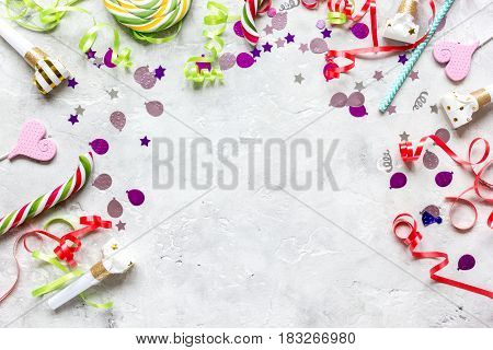 Colored party spiral sweets and confetti on stone table background top view mockup