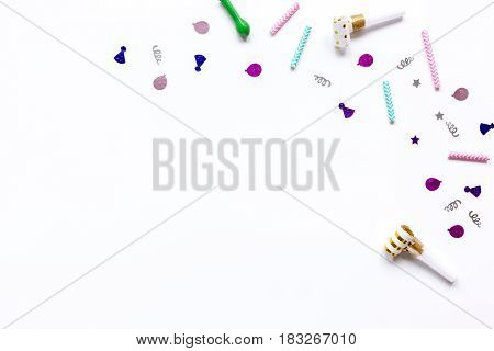 birthday party design with colorful confetti on white table background top view space for text