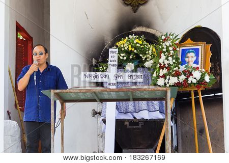 CHIANG RAI THAILAND - APRIL 19 : unidentified asian man speaking next to the white cross and a coffin on April 19 2017 in Chiang rai Thailand.