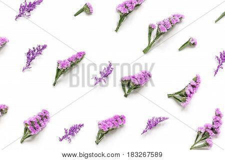 modern spring design in pastel color with purple flowers on white background top view pattern