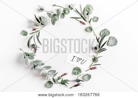 spring with morden green herbal mockup and calligraphy cards on white desk background top view