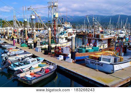 March 15, 2017 in Santa Barbara, CA:  Fishing Vessels, yachts, sail boats, and row boats docked at the Santa Barbara Marina where people can take their own yachts out to sea or rent a boat taken in Santa Barbara, CA