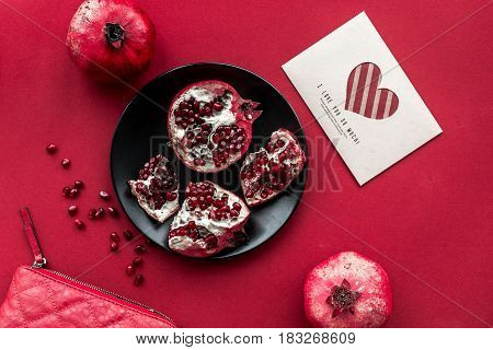 red set with cut pomegranate for restaurant menu top view