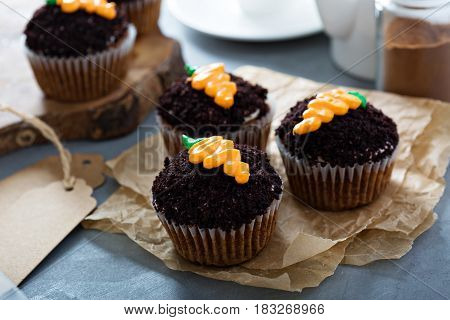 Carrot cupcakes with chocolate crumbs and cream cheese frosting