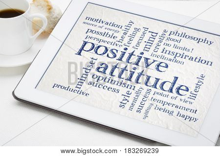 positive attitude and mindset word cloud on a digital tablet with a cup of coffee