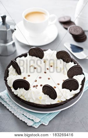 Cookies and cream tart decorated with chocolate sandwich cookies