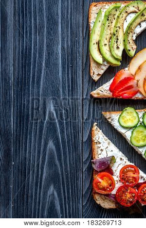 healthy breakfast with sandwiches set on dark wooden table background top view mockup