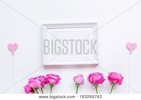 Present for woman with pink peony, frame, hearts on white background top view space for text