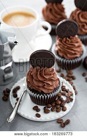 Chocolate coffee cupcakes with dark frosting decorated with sandwich cookies