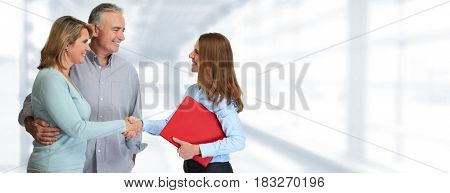 Senior couple with estate agent