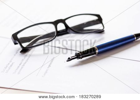 businessman work with office desk and contract for signing, glasses and pen