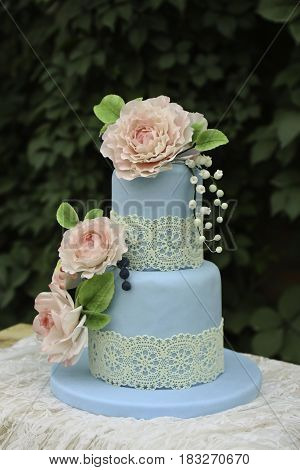 simple wedding fondant cakes, green tree on the background