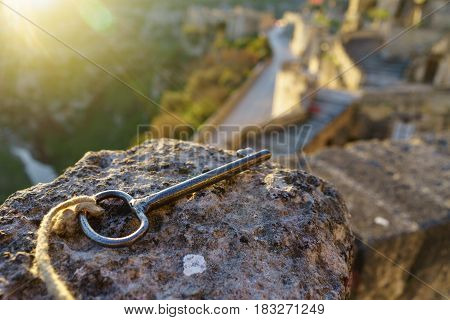 Vintage key on the stone with sun light in the morning as key to heaven concept.
