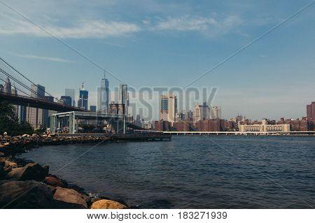 Brooklyn's Carousel and Manhattan Skyline on a Sunny Day