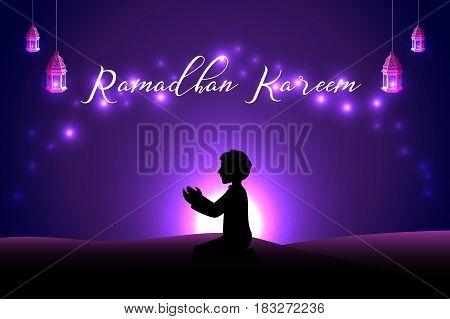 Muslim man praying silhouette at the desert night day