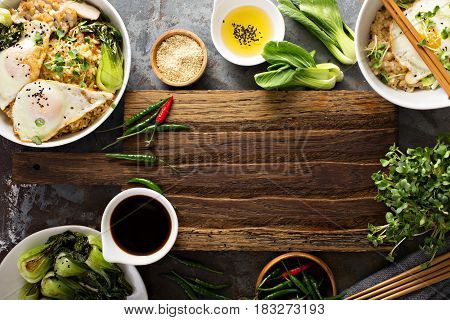 Asian food concept with fried rice, baby bok choy, eggs and soy sauce with copyspace