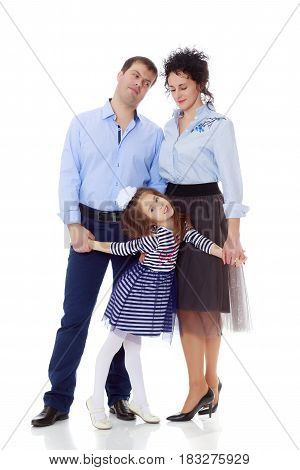 Happy young family, mom dad and little daughter.The parents keep the girl's hands.Isolated on white background.