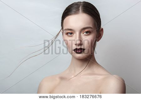 beauty woman head and shoulders portrait whith makeup over white background, clear shiny skin dark red lips