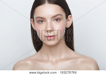 beauty woman head and shoulders portrait whith makeup over white background, clear shiny skin