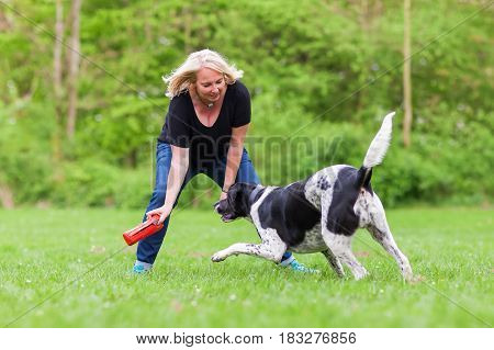 Woman Plays With Her Dog Outdoors