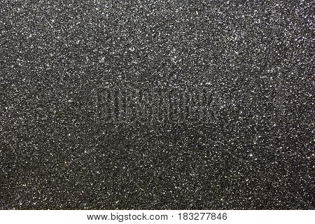 Tinsel background. Silver sparkling abstract texture. Horizontal