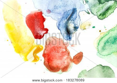 Watercolor abstraction. Colored spots on white paper. Blending colors. Red yellow blue and green colors.