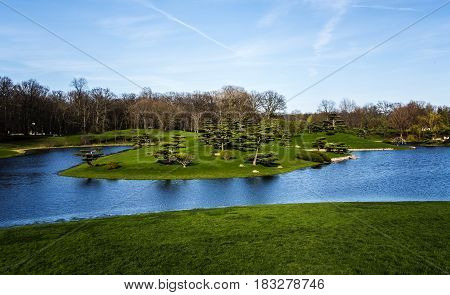 landscape, green landscape, relaxing botanic garden with blue lake and green landscape in the spring, chicago botanic garden landscape, landscape concept, water landscape, spring landscape, landscape with trees water and flowers