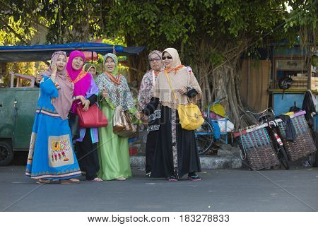 Yogyakarta, Indonesia - september 15, 2015: Colorful Indonesian muslim women walking at the streets of Yogyakarta, Indonesia