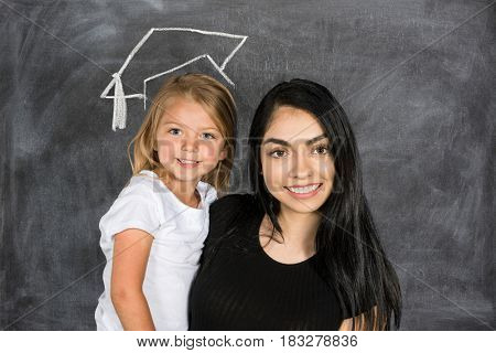 Student with her teacher graduation from school