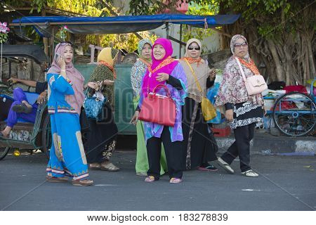 Yogyakarta, Indonesia - september 15, 2015: Colorful Indonesian moslim women walking at the streets of Yogyakarta, Indonesia