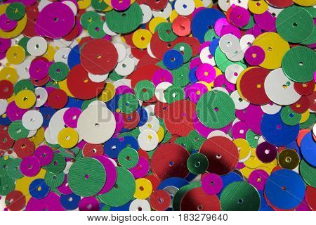 This is a photograph of colorful craft sequins