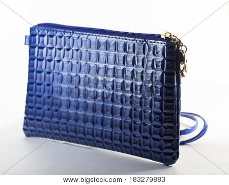 Small female bag of blue color on a white background