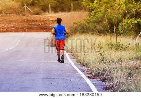 Men jogging in the afternoon on a hot day.