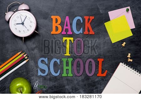 School Stationery Or Office Supplies On Chalkboard Background.