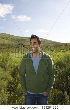 Mixed race standing in field