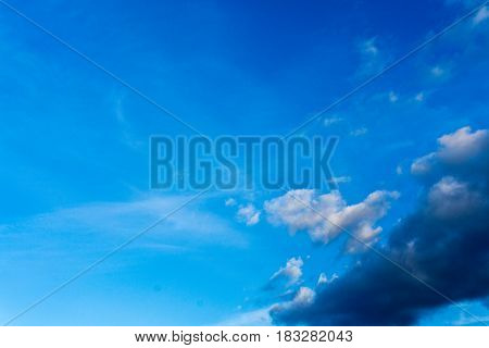 Blue sky with dark clouds as background