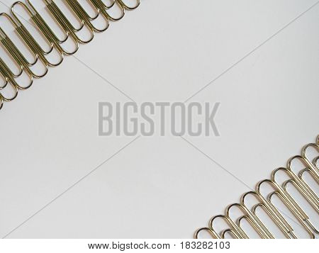 Silver Paper Clips On A White Background With Free Text Space.