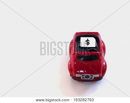 Sim card tray and small paper simulated as a SIM card on a red toy car with white background. Dollar symbol on paper sim card