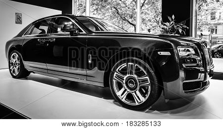 BERLIN - JUNE 14 2015: Full-size luxury car Rolls-Royce Ghost (since 2010). Black and white. The Classic Days on Kurfuerstendamm.