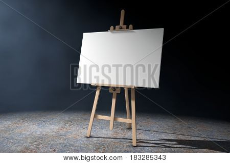 Wooden Artist Easel with White Mock Up Canvas in the volumetric light on a black background. 3d Rendering.