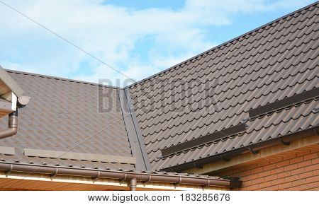 Problem Areas for House Metal Corner Roofing Construction Waterproofing. Rain gutter system and roof protection from snow board (Snow guard) on house roofing.   Guttering.