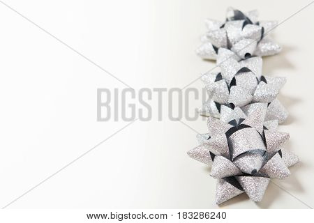 Silver Holiday Bows On White Background