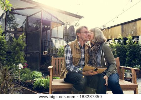 Senior Adult Couple Resting Reading Book Together Love