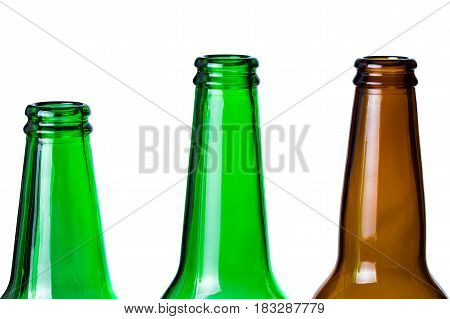 Green and brown glass bottles necks isolated on white background.