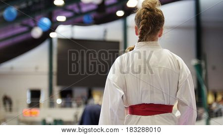 Sport teenagers - female sportsmen on karate - ready for fight, close up