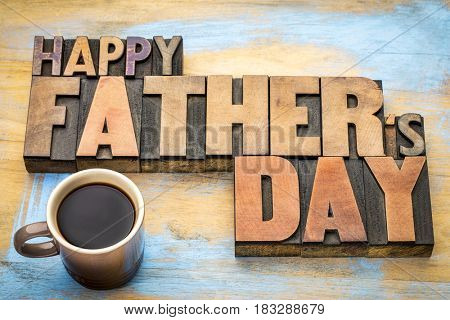 happy father's day greeting card in vintage letterpress wood type printing blocks with a cup of coffee