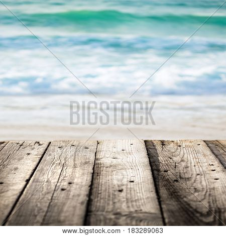 Closeup picture of a boardwalk over sea background, conceptual photo of summer time and relaxation, vacation near ocean