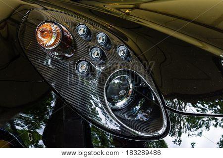 BERLIN - JUNE 14 2015: Headlamp of the sports car Alfa Romeo 4C (since 2014). The Classic Days on Kurfuerstendamm.